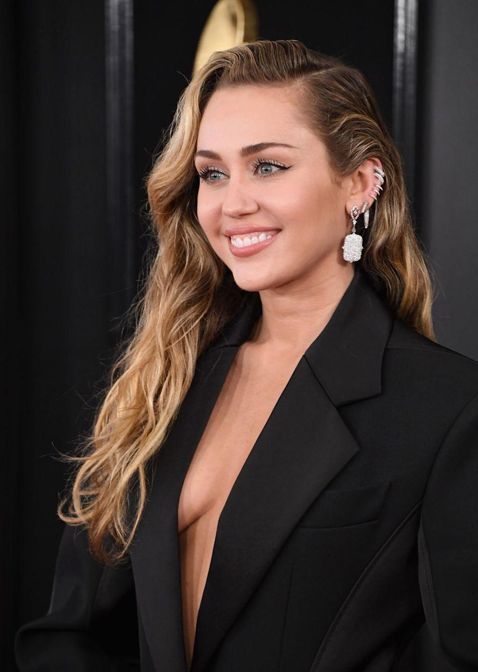 <p>Miley's rock'n'roll sparkly run of hoops is all the convincing we need to start planning our new pierced ear makeover. </p>