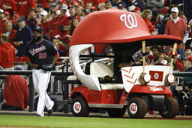 Washington Nationals relief pitcher Fernando Rodney gets out of the bullpen car as he come into the game during the sixth inning of Game 3 of the baseball World Series against the Houston Astros Friday, Oct. 25, 2019, in Washington. (AP Photo/Patrick Semansky)