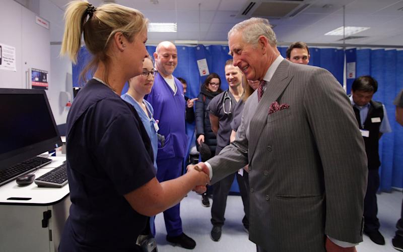Prince Charles shakes a medic's hand in hospital - Credit: Yui Mok/PA
