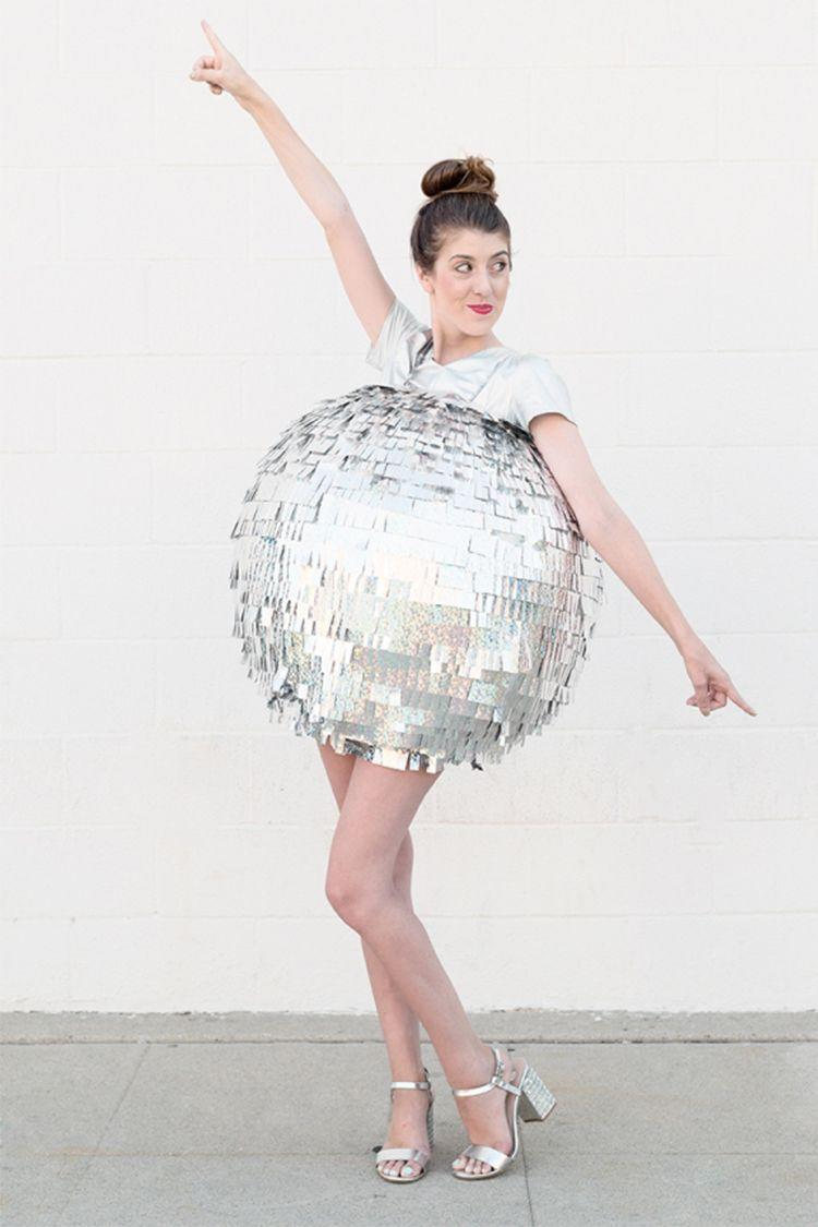 """<p>Who needs disco fever when you can be the actual disco ball?! This fun little number takes some creativity, but Studio DIY shows us how easy it is to put together with a bit of paper-mache. </p><p><a href=""""https://studiodiy.com/diy-disco-ball-costume/"""" rel=""""nofollow noopener"""" target=""""_blank"""" data-ylk=""""slk:Get the tutorial at Studio DIY »"""" class=""""link rapid-noclick-resp""""><em>Get the tutorial at Studio DIY »</em></a></p>"""