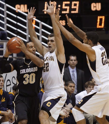 Colorado's Carlon Brown (30) looks to pass as California's Harper Kamp, center, and Allen Crabbe defend during the first half of an NCAA college basketball game, Thursday, Jan. 12, 2012, in Berkeley, Calif. (AP Photo/George Nikitin)