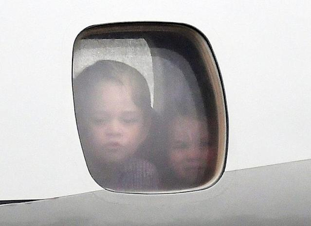 As the plane carrying the family of four arrived in Warsaw, Prince George and Princess Charlotte were seen peeking out a plane window — to the delight of royal fans globally. (Photo: PA)