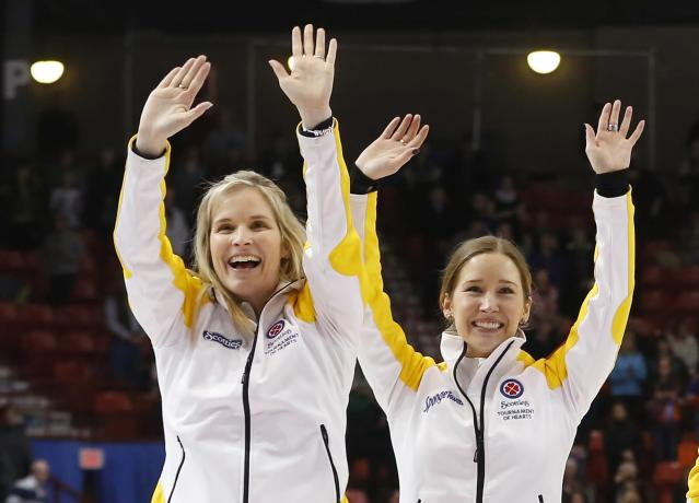 Manitoba skip Jennifer Jones (L) celebrates with third Kaitlyn Lawes after they defeated Alberta in the gold medal game during the Scotties Tournament of Hearts in Moose Jaw, Saskatchewan, February 22, 2015. REUTERS/Todd Korol (CANADA - Tags: SPORT CURLING)