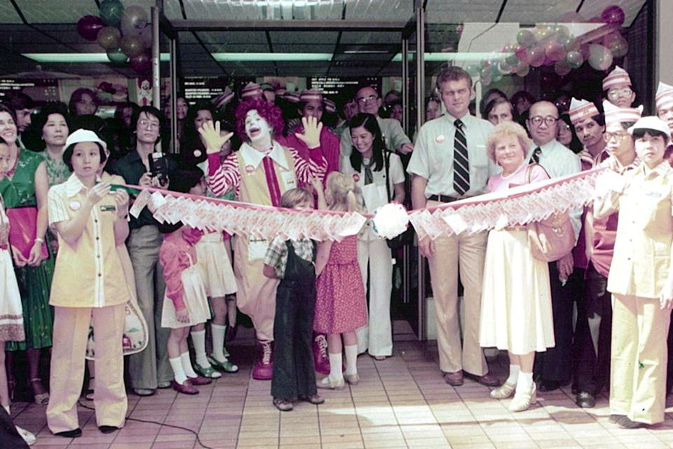 Ronald McDonald presides over the opening of Singapore's first McDonald's at Liat Towers on 20 October 1979. Female staff wore yellow uniforms then, while the money tied to the red ribbon was donated to charity (PHOTO: McDonald's Singapore)