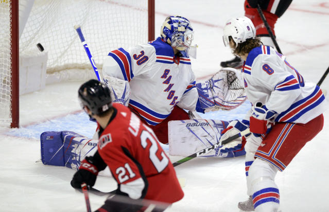 Ottawa Senators center Logan Brown (21) slips the puck past New York Rangers goaltender Henrik Lundqvist (30) to score his first NHL goal, during the first period of an NHL hockey game Friday, Nov. 22, 2019, in Ottawa, Ontario. (Sean Kilpatrick/The Canadian Press via AP)