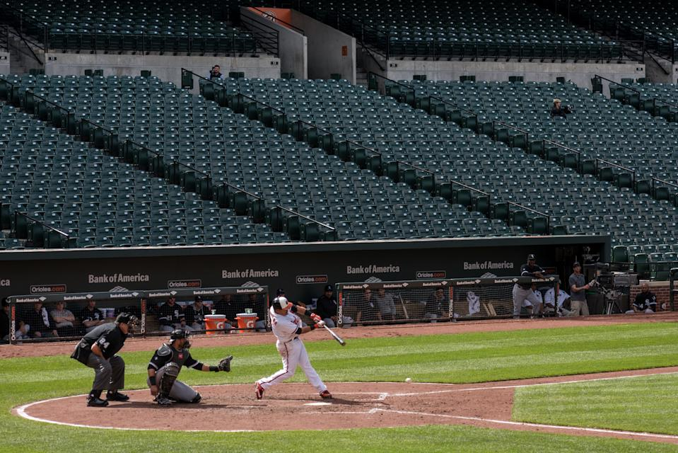 A batter hits the ball In the final inning against the Chicago White Sox in an empty Oriole Park at Camden Yards in Baltimore, MD April 29, 2015. The closing of the game to fans follows the unrest related to the death of city resident Freddie Gray who was arrested for possessing a switch blade knife and died while in custody of the Baltimore Police. Photo Ken Cedeno (Photo by Ken Cedeno/Corbis via Getty Images)