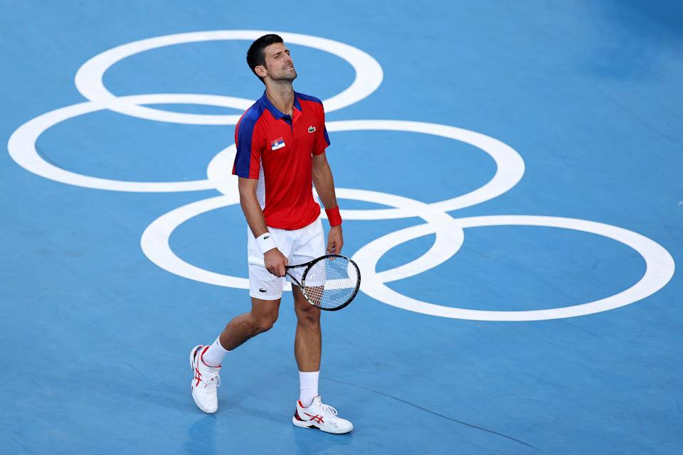 TOKYO, JAPAN - JULY 31: Novak Djokovic of Team Serbia reacts after a point during his Men's Singles Bronze Medal match against Pablo Carreno Busta of Team Spain on day eight of the Tokyo 2020 Olympic Games at Ariake Tennis Park on July 31, 2021 in Tokyo, Japan. (Photo by Clive Brunskill/Getty Images)