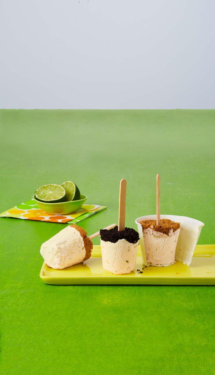"""<p>You don't even need pop molds to make these graham cracker-crusted treats. Just use paper cups!</p><p><em><a href=""""https://www.womansday.com/food-recipes/food-drinks/recipes/a59411/key-lime-ice-pops-recipe/"""" rel=""""nofollow noopener"""" target=""""_blank"""" data-ylk=""""slk:Get the recipe from Woman's Day »"""" class=""""link rapid-noclick-resp"""">Get the recipe from Woman's Day »</a></em></p>"""