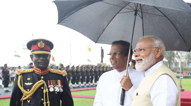 Modi in Sri Lanka, Narendra Modi, Modi umbrella, Maithripala Sirisena, Ranil Wickremesinghe, Sri Lanka bombings, terrorism, indian express