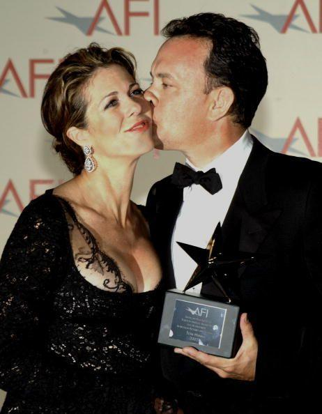 """<p>Tom kissed his wife after he received the 30th AFI Life Achievement Award on June 12 in Hollywood. That year, they also co-produced my <em><a href=""""https://www.amazon.com/My-Big-Fat-Greek-Wedding/dp/B003KGIOY0/?tag=syn-yahoo-20&ascsubtag=%5Bartid%7C10055.g.3131%5Bsrc%7Cyahoo-us"""" rel=""""nofollow noopener"""" target=""""_blank"""" data-ylk=""""slk:Big Fat Greek Wedding"""" class=""""link rapid-noclick-resp"""">Big Fat Greek Wedding</a></em> (which Rita helped make into a film after the play by the same name resonated with her own Greek heritage). """"I wish there was a secret, you know,"""" Tom once <a href=""""http://www.people.com/article/tom-hanks-talks-happy-marriage-to-rita-wilson"""" rel=""""nofollow noopener"""" target=""""_blank"""" data-ylk=""""slk:told People"""" class=""""link rapid-noclick-resp"""">told <em>People</em></a> of their enduring marriage. """"We just like each other. You start there."""" That said, he does have one piece of advice: """"No one should get married before they're 30,"""" he continued.</p>"""