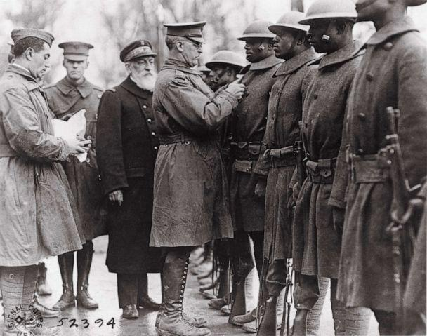 PHOTO: Soldiers of the 369th Regiment receive medals awarded to them by France for their valor in battle along the French Army in World War I.  (Signal Corps/Courtesy Washington University Libraries)