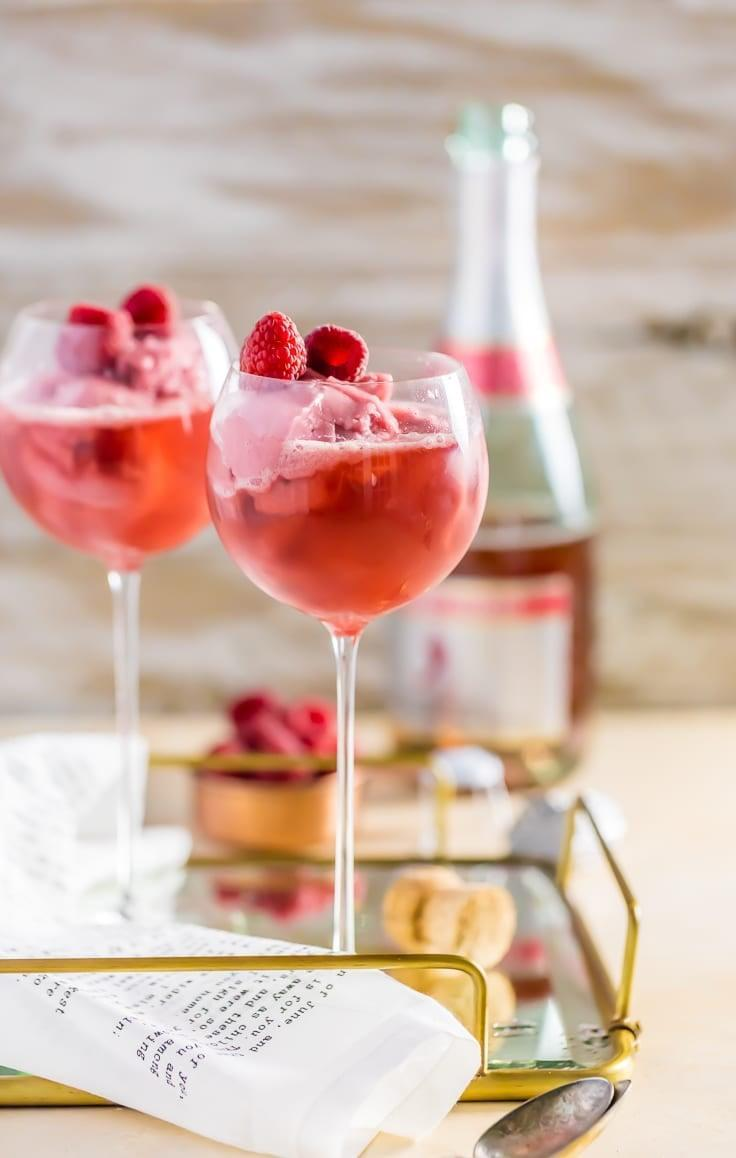 """<p>Any cocktail with Champagne as a main ingredient is a winner in our book, and adding raspberry sorbet takes it over the top as a float! Top everything off with fresh raspberries for a light and refreshing treat.</p> <p><strong>Get the recipe:</strong> <a href=""""http://www.thecookierookie.com/raspberry-pink-champagne-floats/#wprm-recipe-container-32536"""" class=""""link rapid-noclick-resp"""" rel=""""nofollow noopener"""" target=""""_blank"""" data-ylk=""""slk:raspberry sorbet pink Champagne float"""">raspberry sorbet pink Champagne float</a></p>"""