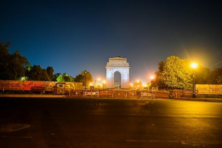 An empty street is seen in New Delhi as the Indian capital imposed a night curfew to try to curb the spread of the coronavirus