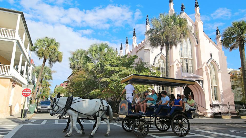 Charleston, South Carolina USA - October 12, 2015Horse Drawn Carriage Ride by French Huguenot Church.