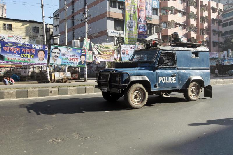 A Bangladeshi security vehicle patrols on the second day of a four-day general strike in Dhaka, Bangladesh, Monday, Nov. 11, 2013. Opposition enforced a four-day general strike to force Prime Minister Sheikh Hasina to quit and form a caretaker government made up of people from outside of mainstream political parties to oversee an election next year. (AP Photo/A.M. Ahad)