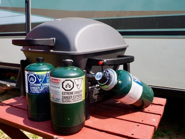 The 16-ounce steel canisters of propane, used by many campers for portable stoves and barbecues, are in short supply.   (Therese Kehler/CBC News - image credit)