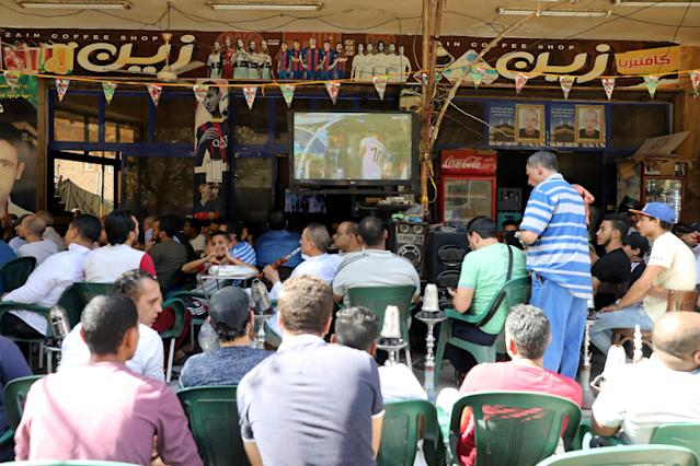 Egyptian soccer fans watch the World Cup 2018 match between Egypt and Uruguay, at a cafe in Cairo, Egypt June 15, 2018. REUTERS/Mohamed Abd El Ghany