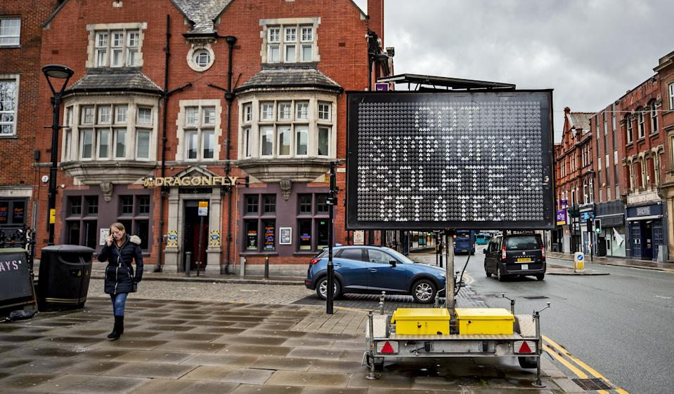 An electronic notice board in Bolton town centre, one of the areas of the UK where the Covid variant first identified in India is spreading fastest. Picture date: Tuesday May 25, 2021.