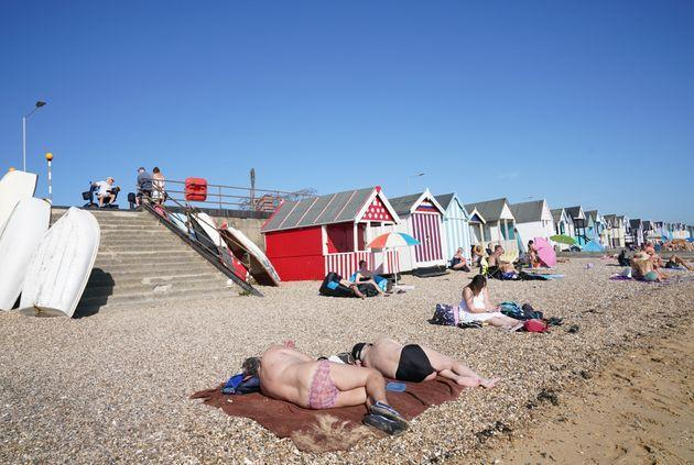 People enjoy the warm weather on the beach at South End on Sea, Essex. (Photo: Stefan RousseauPA)