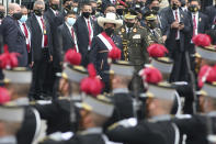 Peru's newly sworn-in President Pedro Castillo exits Congress on his inauguration day in Lima, Peru, Wednesday, July 28, 2021. (AP Photo/Francisco Rodriguez)