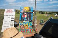 A sign welcomes visitors at the entrance to an oil pipeline protest encampment near Cannon Ball, North Dakota (AFP Photo/Robyn Beck)