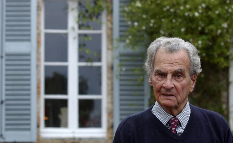 """File - In this Dec. 30, 2001 picture British travel writer Sir Patrick Leigh Fermor, is seen at his house in Kardamyli, Greece.  Fermor known for his World War II exploits behind enemy lines in Crete, died in Britain on Friday. He was 96. Greece's Culture Ministry expressed deep sorrow at the writer's death, calling him one of Greece's most significant cultural ambassadors in the world. """"Patrick Leigh Fermor, perhaps the greatest contemporary travel writer, loved Greece as his second country,"""" a ministry statement said. (AP Photo/Thanassis Stavrakis, file)"""