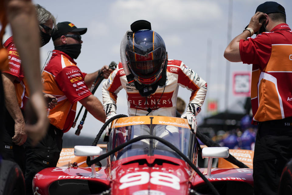 Marco Andretti climbs into his car during practice for the Indianapolis 500 auto race at Indianapolis Motor Speedway, Thursday, May 20, 2021, in Indianapolis. (AP Photo/Darron Cummings)