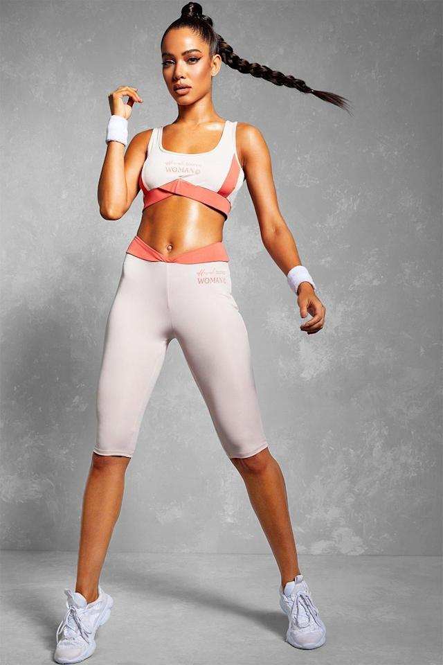 "<p>Get sweaty in this <a href=""https://www.popsugar.com/buy/Boohoo-Fit-Woman-Sports-Bra-Cycling-Shorts-Set-548941?p_name=Boohoo%20Fit%20Woman%20Sports%20Bra%20Cycling%20Shorts%20Set&retailer=us.boohoo.com&pid=548941&price=19&evar1=fit%3Aus&evar9=47217672&evar98=https%3A%2F%2Fwww.popsugar.com%2Ffitness%2Fphoto-gallery%2F47217672%2Fimage%2F47217674%2FBoohoo-Fit-Woman-Sports-Bra-Cycling-Shorts-Set&list1=shopping%2Cworkout%20clothes%2Cproducts%20under%20%2450%2Cboohoo%2Cfitness%20shopping%2Caffordable%20shopping&prop13=mobile&pdata=1"" rel=""nofollow"" data-shoppable-link=""1"" target=""_blank"" class=""ga-track"" data-ga-category=""Related"" data-ga-label=""https://us.boohoo.com/fit-woman-sports-bra-cycling-shorts-set/FZZ74709.html"" data-ga-action=""In-Line Links"">Boohoo Fit Woman Sports Bra Cycling Shorts Set</a> ($19, originally $37).</p>"