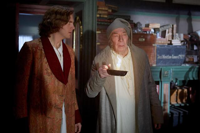 Dan Stevens as Charles Dickens and Christopher Plummer as Scrooge in <em>The Man Who Invented Christmas</em> (Photo: Bleecker Street Media /Courtesy of Everett Collection)