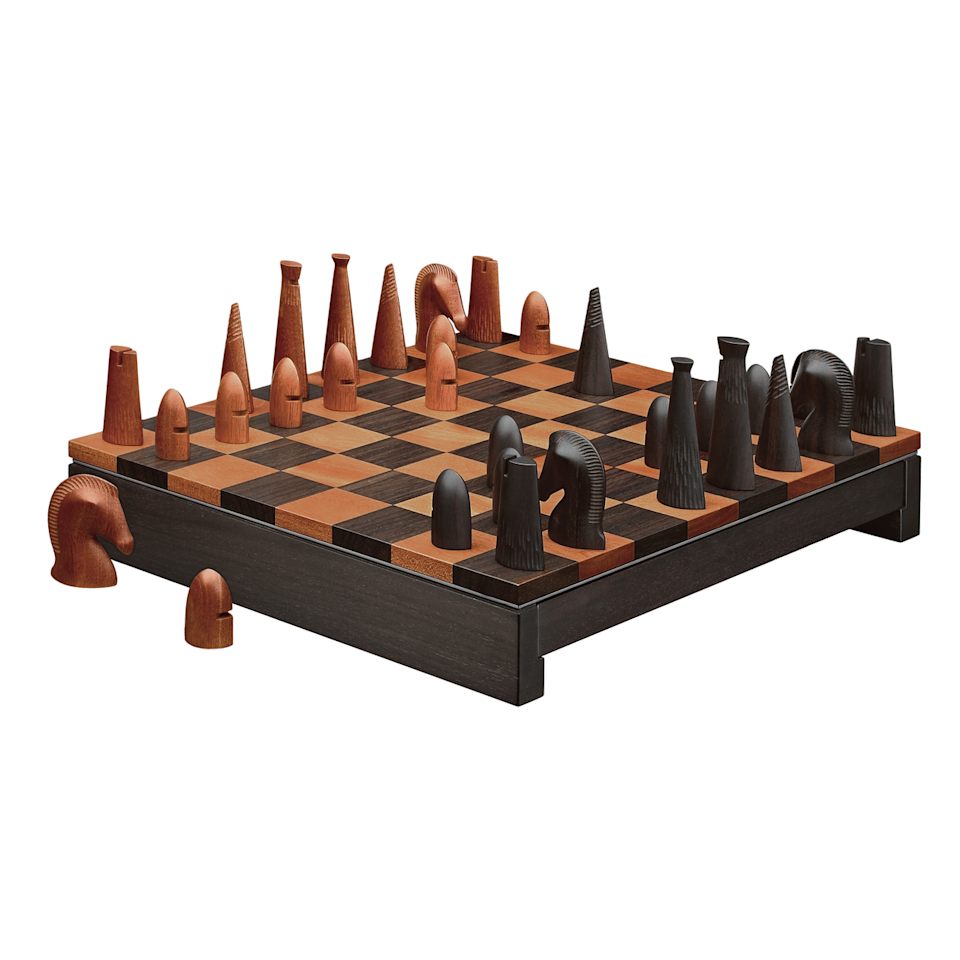 "The <a href=""https://www.hermes.com/us/en/product/samarcande-chess-set-H400123Mv01/"">Samarcande chess set</a> by Hermès features carved pieces that put an abstract spin on the traditional chessmen. Made of java solid palissander wood and mahogany, the set costs $6,400."