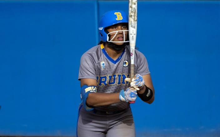 UCLA outfielder Maya Brady stares at her bat before stepping into the batters box during a game against Oregon State.
