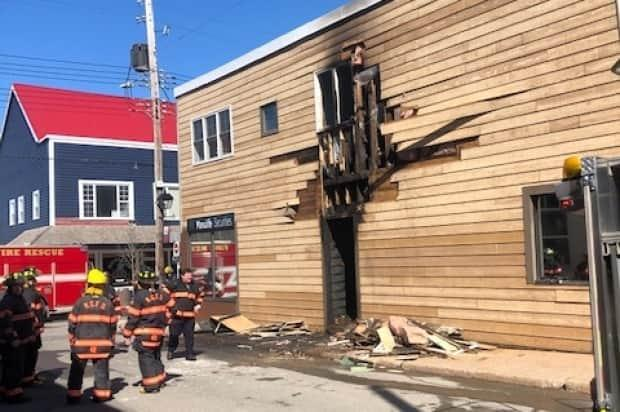 Firefighters at the scene of a fire in a building in downtown New Glasgow on April 11, 2021