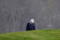 FILE PHOTO: U.S. President Donald Trump plays golf at the Trump National Golf Club in Sterling, Virginia