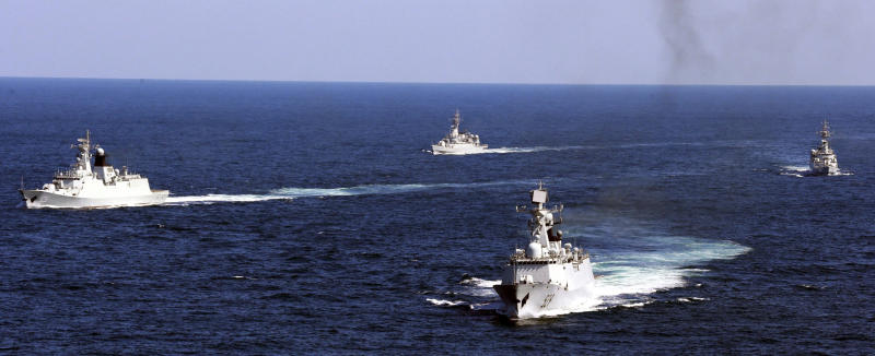 FILE - In this Oct. 19, 2012, file photo, Chinese navy vessels take part in a drill in the waters off Zhoushan in east China's Zhejiang province.  China says it will increase its defense spending by 6.6% in 2020, despite a major downturn in the country's economic growth due to the coronavirus outbreak. (AP Photo, File)