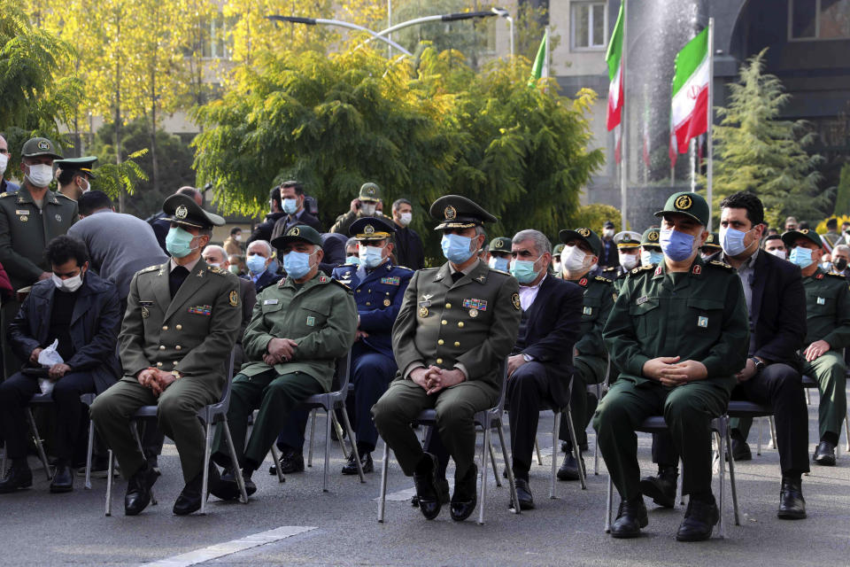 """In this photo released by the official website of the Iranian Defense Ministry, military military commanders attend a funeral ceremony of Mohsen Fakhrizadeh, a scientist who was killed on Friday, in a funeral ceremony in Tehran, Iran, Monday, Nov. 30, 2020. Iran held the funeral Monday for the slain scientist who founded its military nuclear program two decades ago, with the Islamic Republic's defense minister vowing to continue the man's work """"with more speed and more power."""" (Iranian Defense Ministry via AP)"""