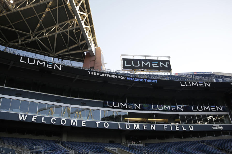 Signs that read Lumen Field, the new name of the stadium where the Seattle Seahawks NFL football team plays, are shown before an NFL football game against the Arizona Cardinals, Thursday, Nov. 19, 2020, in Seattle. The field name was changed because CenturyLink, the current name-rights holder, has rebranded to be named Lumen Technologies. (AP Photo/Lindsey Wasson)