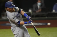 Los Angeles Dodgers' Justin Turner his a home run against the Tampa Bay Rays during the first inning in Game 4 of the baseball World Series Saturday, Oct. 24, 2020, in Arlington, Texas. (AP Photo/Eric Gay)