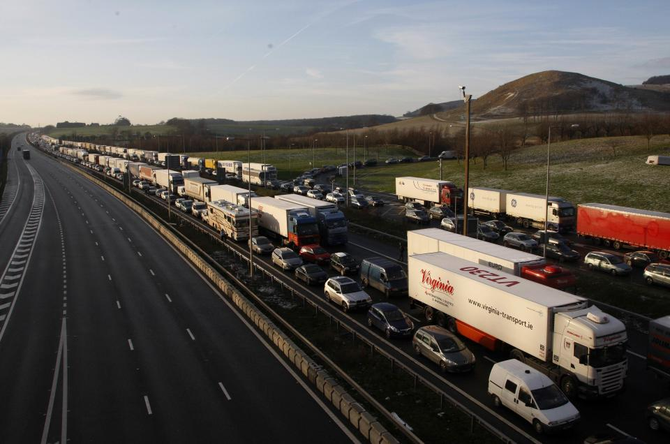 Traffic queues on the M20 motorway and the slip road leading to the Channel Tunnel Terminal, near Folkestone in Kent, southern England December 19, 2009. Rail operator Eurostar cancelled all its services on Saturday because of bad weather, after four trains broke down due to freezing weather conditions, trapping about 2,500 passengers overnight in the undersea Channel Tunnel linking France and Britain   REUTERS/Luke MacGregor (BRITAIN - Tags: ENVIRONMENT TRANSPORT TRAVEL IMAGES OF THE DAY)