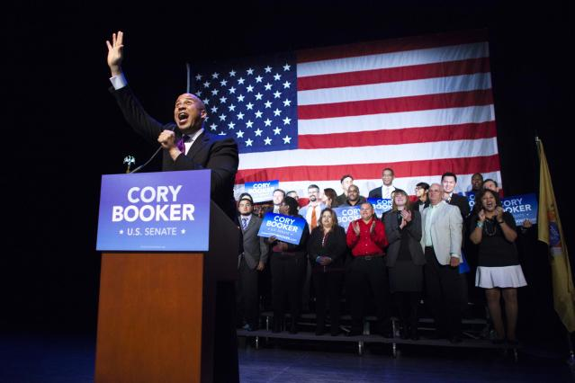 U.S. Senate candidate Cory Booker speaks to guest during his campaign's election night event in Newark, New Jersey, October 16, 2013. Voters headed to the polls on Wednesday in New Jersey, where Booker, the charismatic Democratic mayor of Newark, was heavily favored to beat conservative Republican Steve Lonegan in a special election to fill the state's vacant U.S. Senate seat. REUTERS/Eduardo Munoz (UNITED STATES - Tags: POLITICS ELECTIONS)