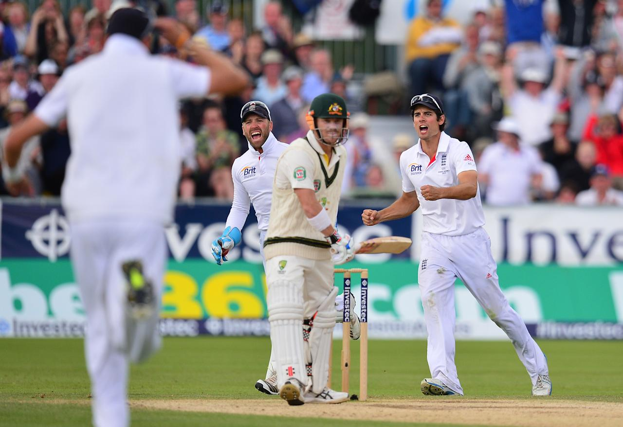 Englands captain Alastair cook and Matt Prior celebrate the wicket of David Warner during day four of the Fourth Investec Ashes test match at the Emirates Durham ICG, Durham.
