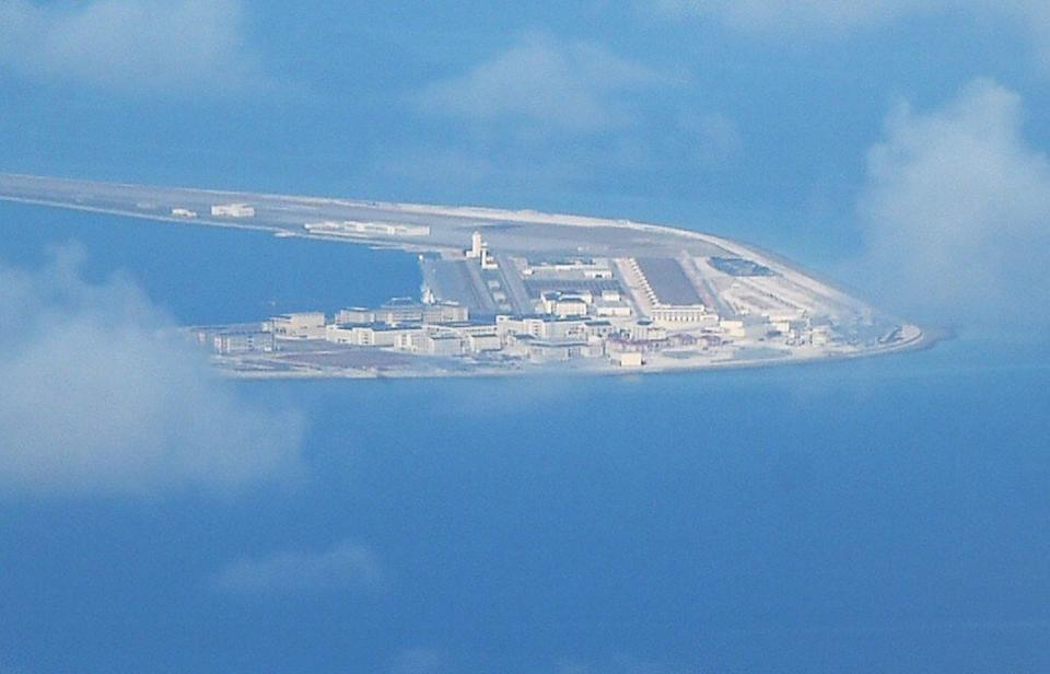 An aerial image, from a Philippine air force plane, of Subi Reef in the South China Sea and claimed by China. Photo: AFP