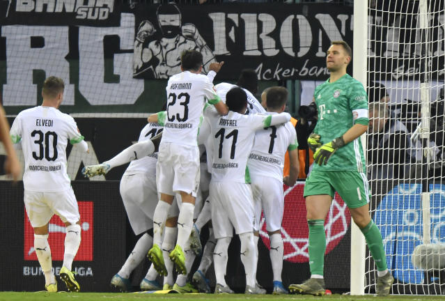 Moenchengladbach's players celebrate their side's second goal scored by Ramy Bensebaini during the German Bundesliga soccer match between Borussia Moenchengladbach and Bayern Munich at the Borussia Park in Moenchengladbach, Germany, Saturday, Dec. 7, 2019. (AP Photo/Martin Meissner)