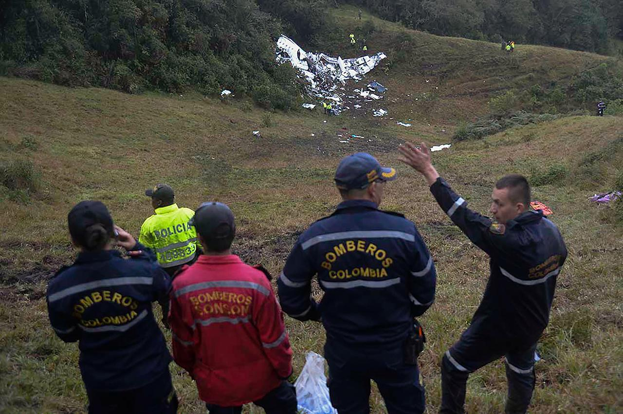 <p>Rescuers gesture near the wreckage of the LAMIA airlines charter plane carrying members of the Chapecoense Real football team that crashed in the mountains of Cerro Gordo, municipality of La Union, on Nov. 29, 2016. (Raul Arboleda/AFP/Getty Images) </p>
