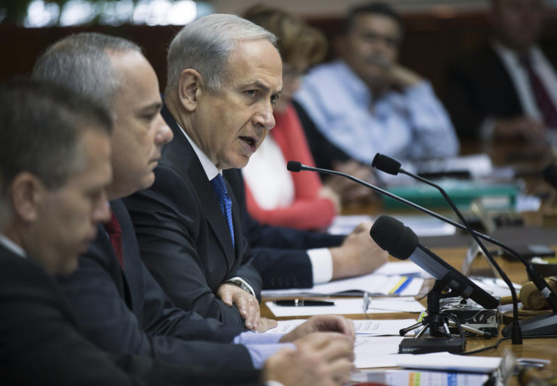 Israel's Prime Minister Benjamin Netanyahu chairs at a weekly cabinet meeting in Jerusalem, Israel, Sunday, June 16, 2013. Netanyahu warned the international community on Sunday against easing sanctions on Iran following the election of Hasan Rowhani, a reformist-backed president, as the country's nuclear efforts remain firmly in the hands of Iran's extremist ruling clerics. (AP Photo/Uriel Sinai, Pool)