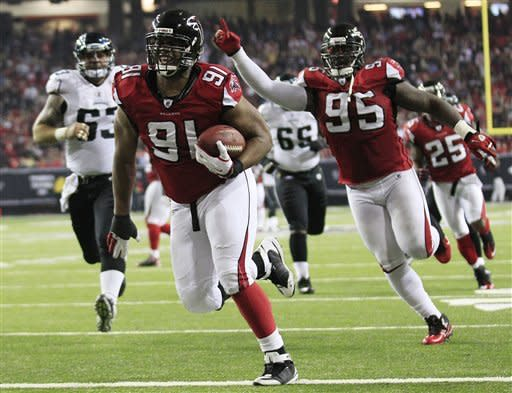 Atlanta Falcons defensive tackle Corey Peters (91) runs a fumbled ball into the end zone during the second half of an NFL football game against the Jacksonville Jaguars, Thursday, Dec. 15, 2011, in Atlanta. (AP Photo/David Goldman)