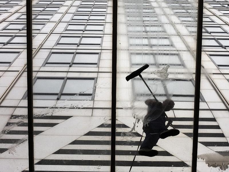 Workmen wash the entrance of 1 Canada Square in London's Canary Wharf, where the European Banking Authority is based - for now: Reuters