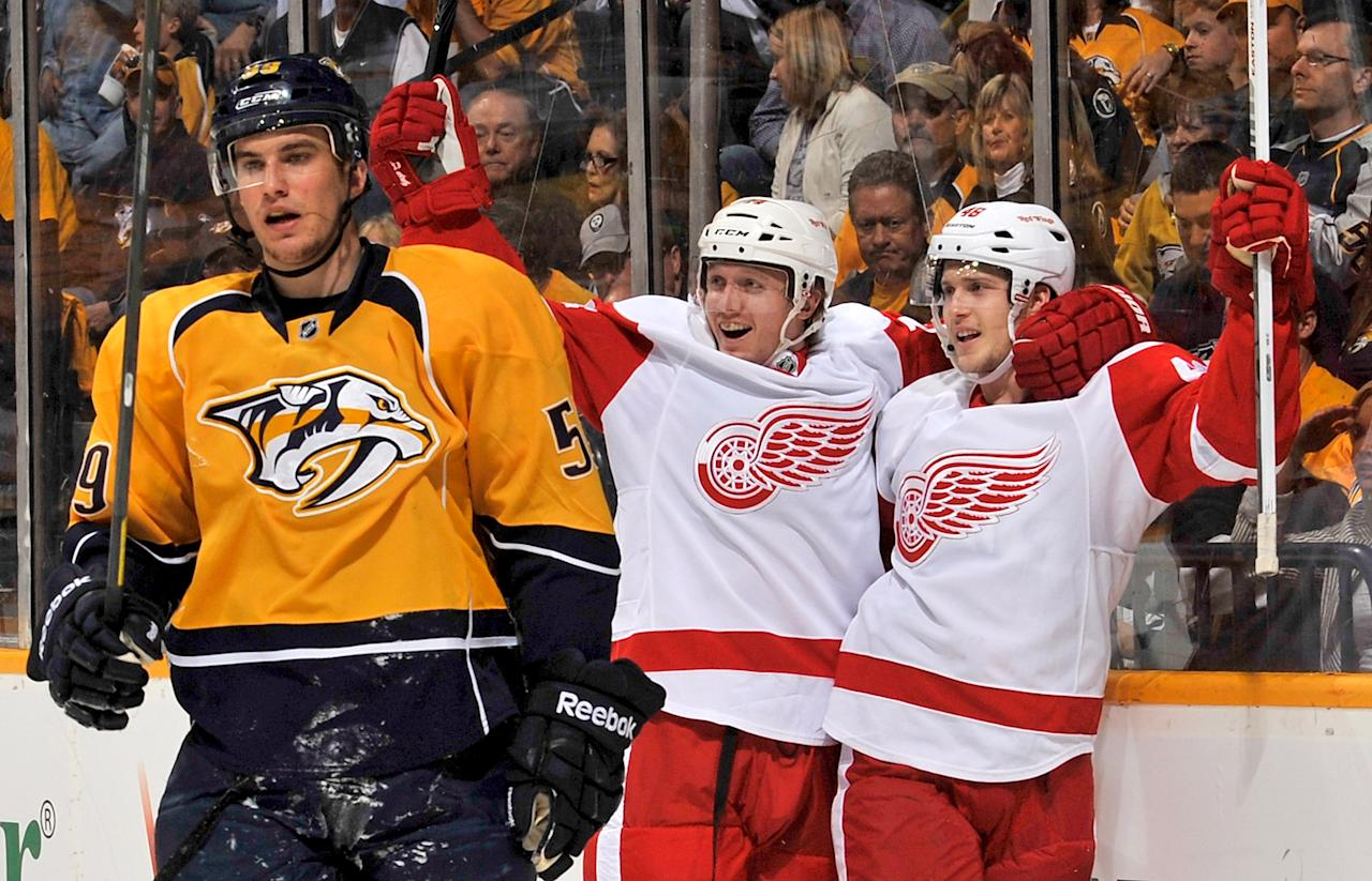 NASHVILLE, TN - APRIL 13:  Cory Emmerton #48 of the Detroit Red Wings celebrates a goal against the Nashville Predators in Game Two of the Western Conference Quarterfinals during the 2012 NHL Stanley Cup Playoffs at the Bridgestone Arena on April 13, 2012 in Nashville, Tennessee.  (Photo by Frederick Breedon/Getty Images)