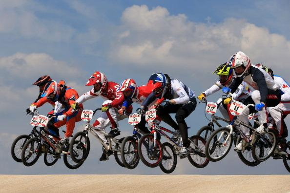 Jelle Van Gorkom (2L) of the Netherlands clears the jump with the pack during the Men's BMX Cycling Quarter Finals on Day 13 of the London 2012 Olympic Games at BMX Track on August 9, 2012 in London, England. (Photo by Phil Walter/Getty Images)