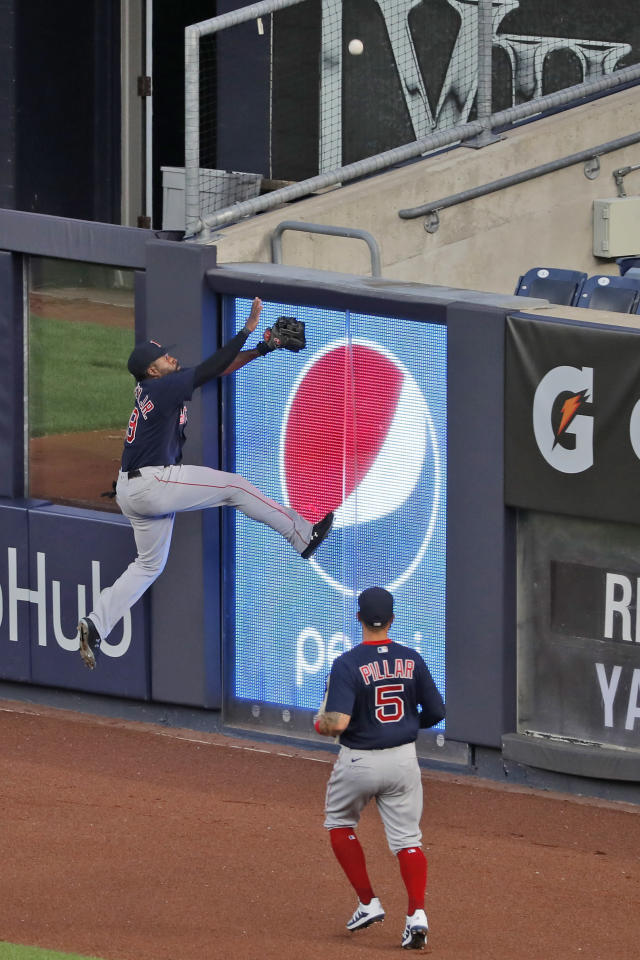Boston Red Sox center fielder Alex Verdugo, left, and right fielder Kevin Pillar try to grab a home run hit by New York Yankees' Aaron Judge during the third inning of the baseball game at Yankee Stadium, Friday, July 31, 2020, in New York. (AP Photo/Seth Wenig)