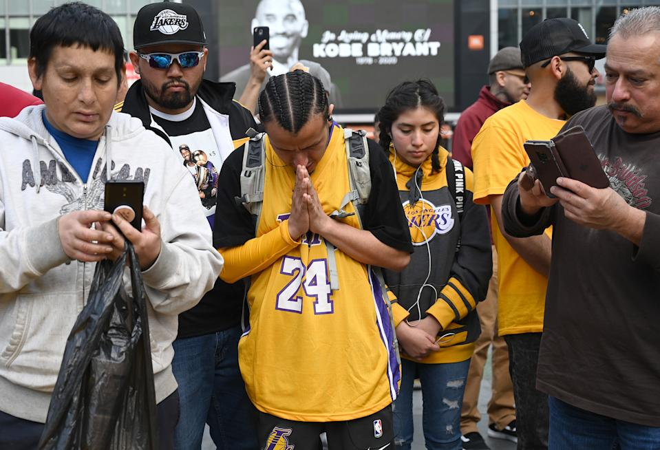Jan 27, 2020; Los Angeles, California, USA; Fans gather at LA Live, across the street from Staples Center, to pay tribute to Kobe Bryant who was killed in a helicopter crash Jan 26, 2020. Mandatory Credit: Jayne Kamin-Oncea-USA TODAY Sports